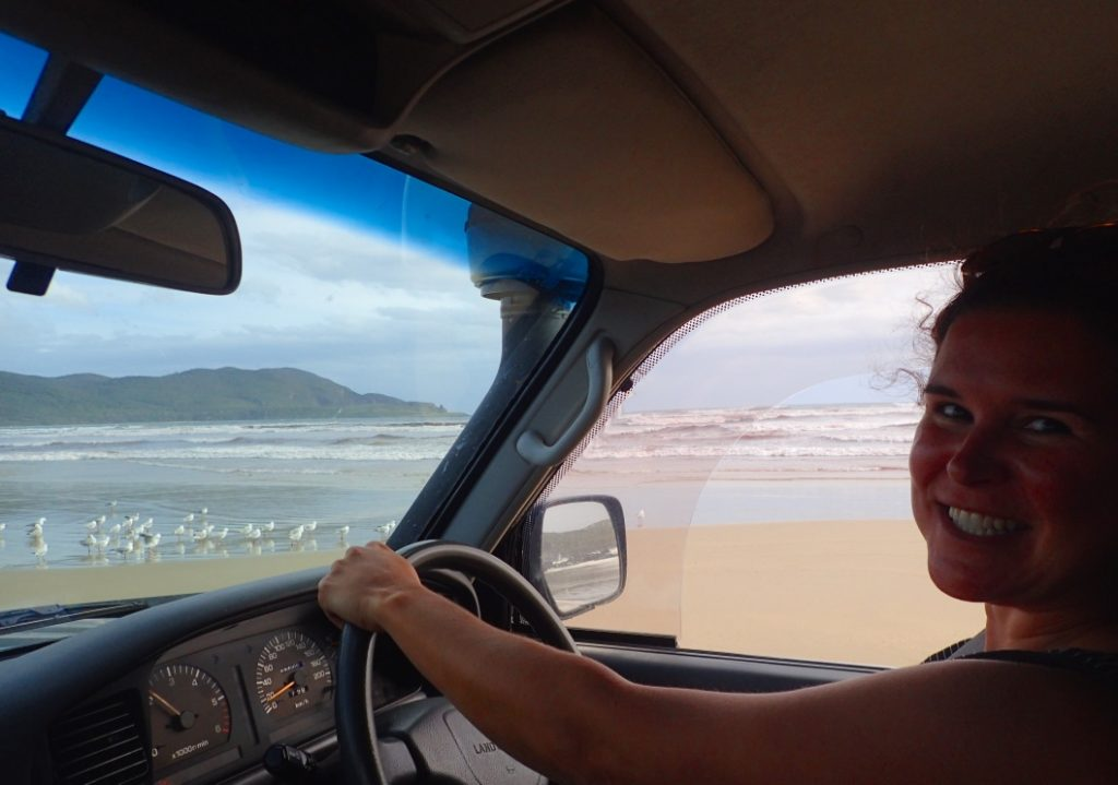 Camila driving on Cloudy Bay, Bruny Island TAS